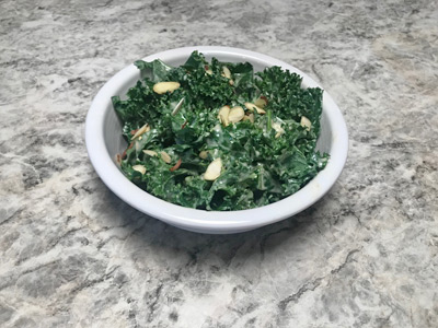 kale-salad-with-creamy-honey-dressing-and-chopped-almonds